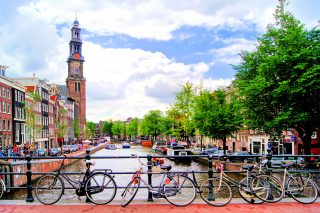 Bicycles lining a bridge over the canals of Amsterdam, Netherlands; Shutterstock ID 112674374